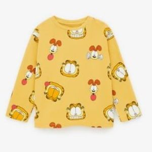 Zara Garfield and Odie Top